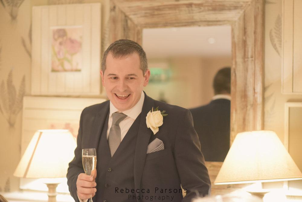 groom smiling during speech