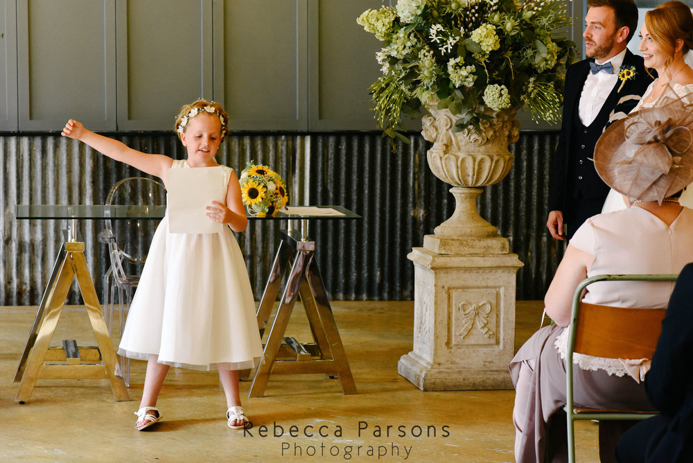 flower girl raised hand during reading