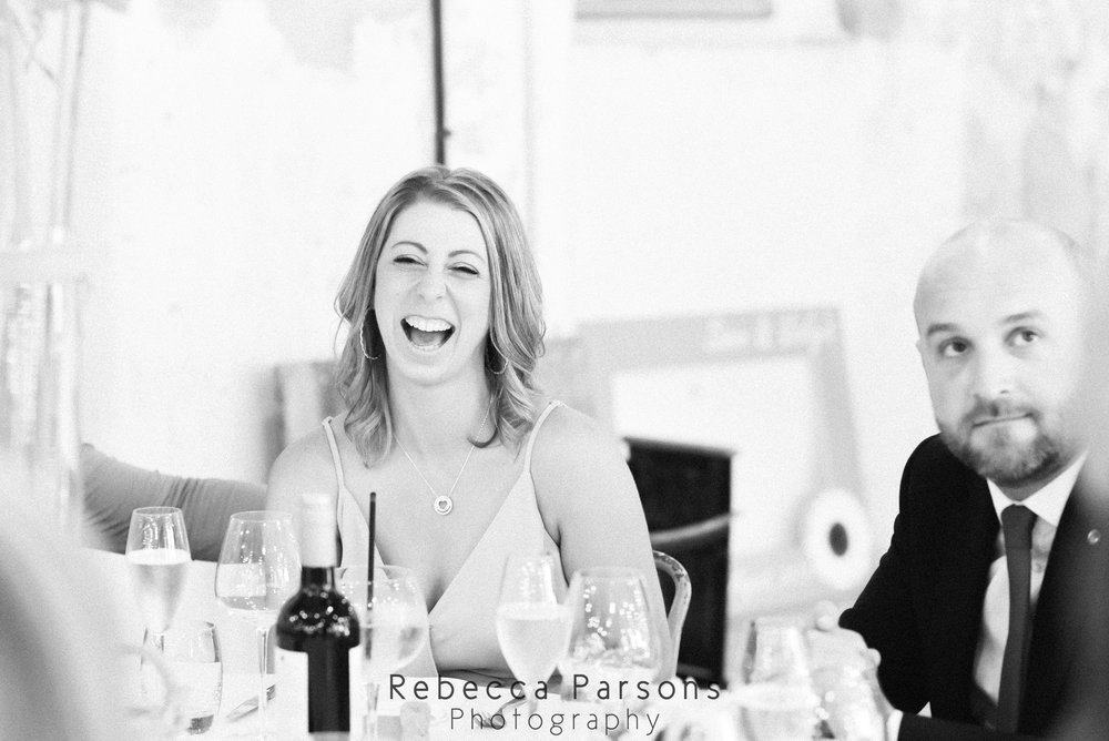 guest laughing black and white