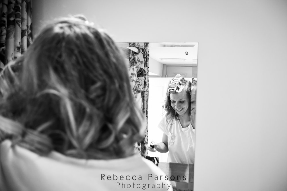 bride reflected in mirror black and white