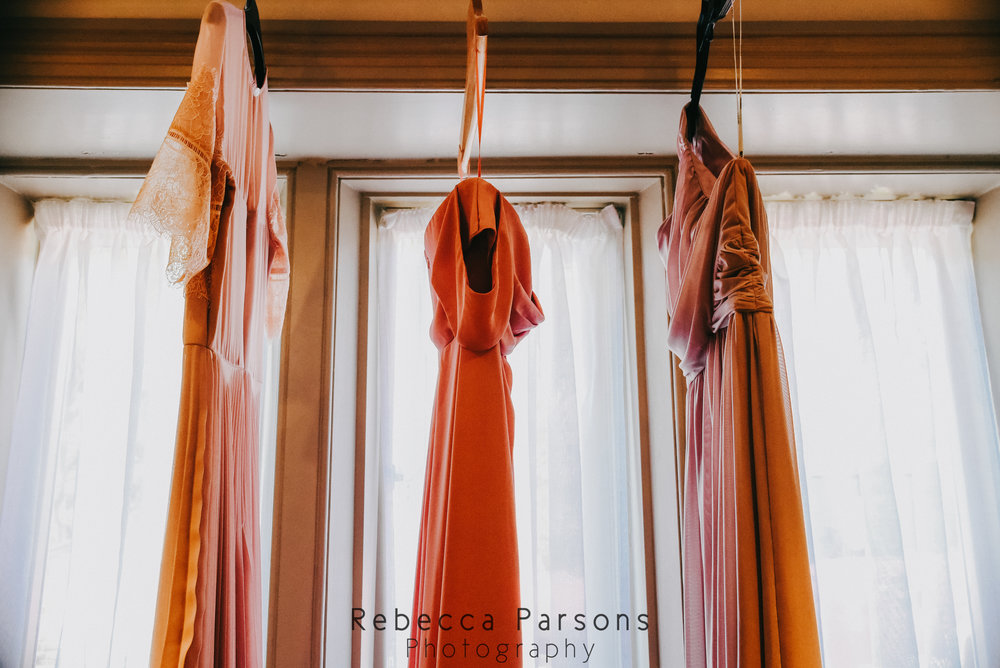 bridesmaid dresses hanging from window