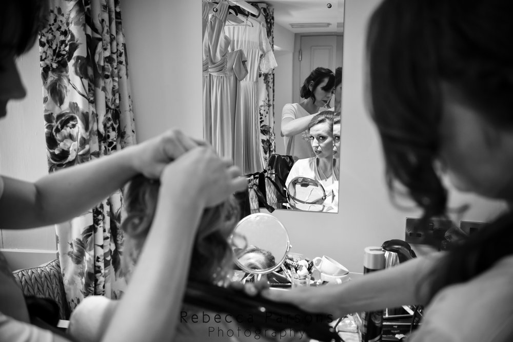 bridesmaids getting bride ready black and white