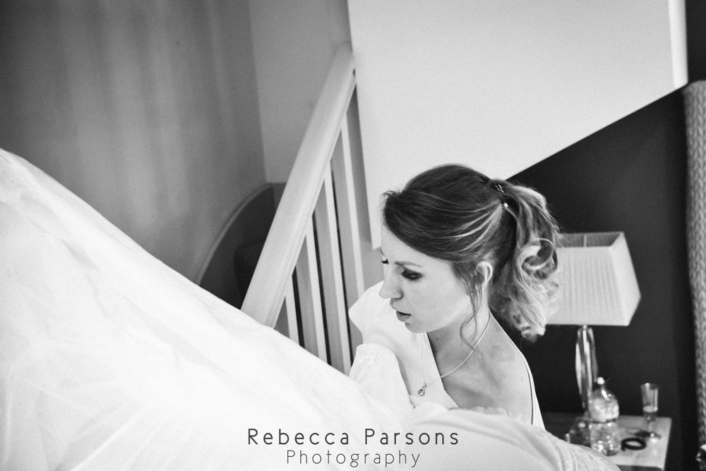 bride putting dress on black and white