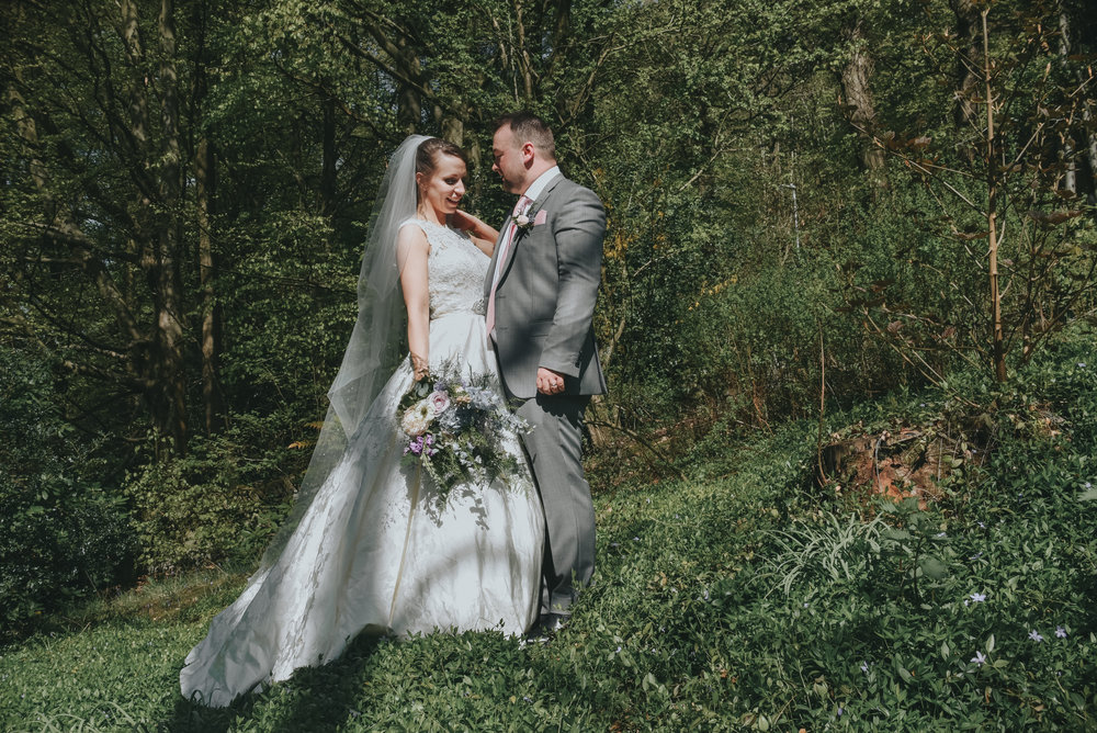 bride and groom in woodland