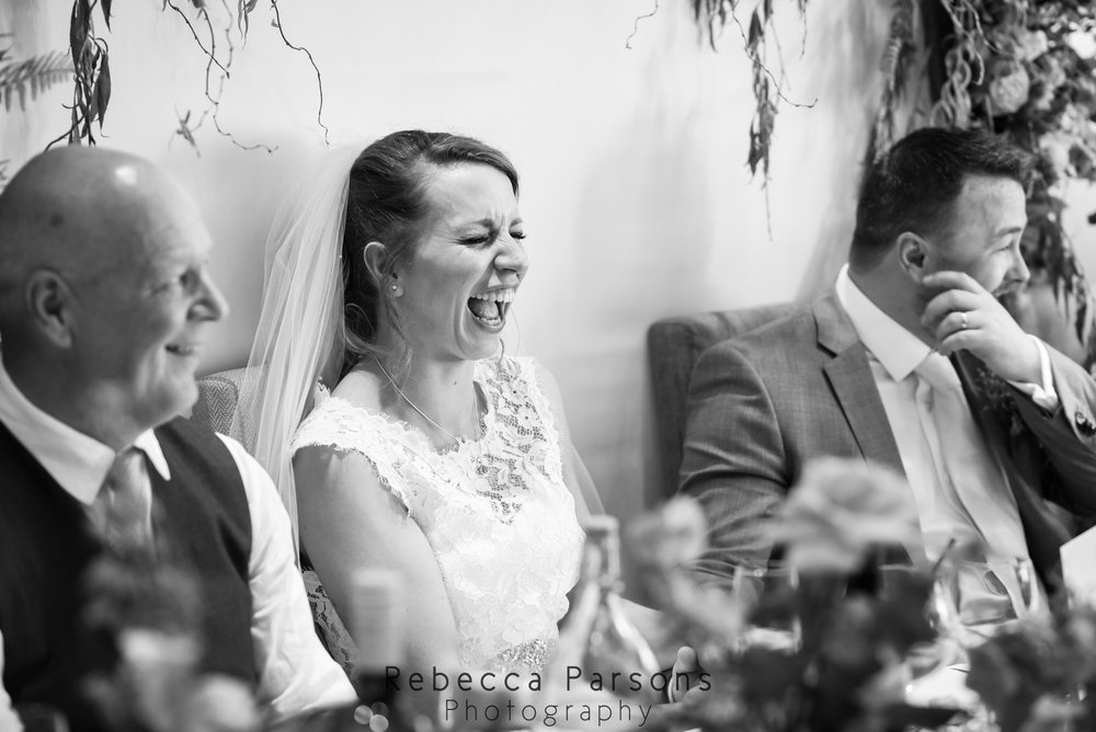 bride and dad laughing black and white