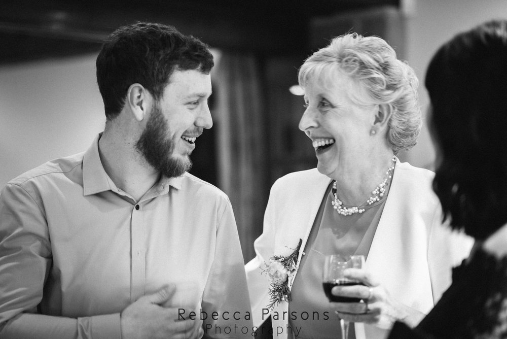 guests laughing black and white