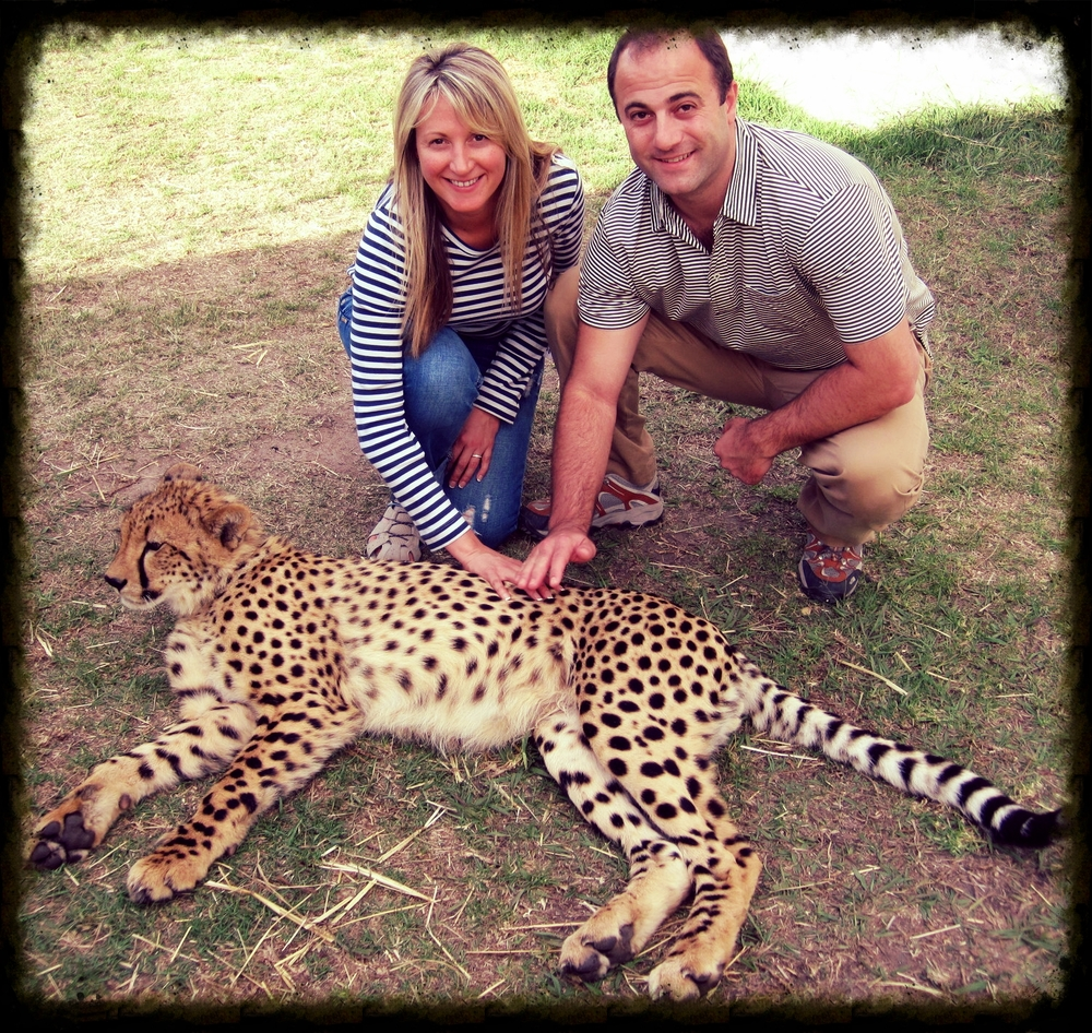 Simon Gluckman with his wife, Emily, at the  Cheetah Outreach  just outside Cape Town, South Africa.