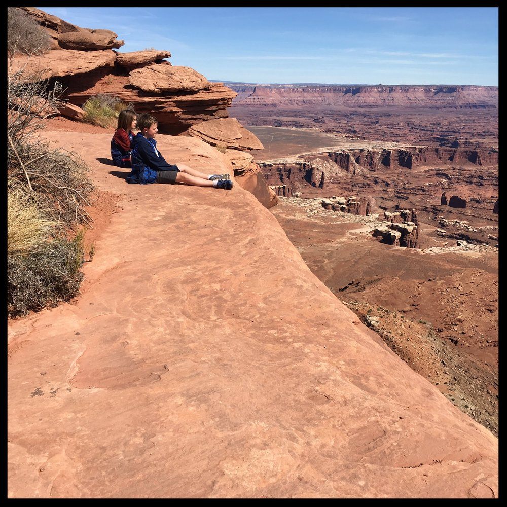 The boys sitting waaaay too close to the edge of the Grand View Point Overlook (IMHO) in Canyonlands NP, our family's final Spring Break road-trip 2018 destination.  Photo by Michael Mundt.