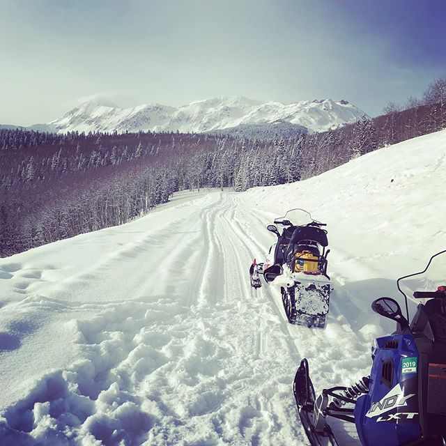 "Day two of a ""beyond the slopes"" #telluride trip: snowmobiling. Something I never tried before—great backcountry views without working too hard. Such a beautiful morning for it. @thehoteltelluride #visittelluride #twopicksandaprayer #hoteltelluride"