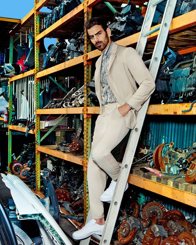 @nyledimarco showing us how to make standing on a ladder look sexy for @manofmetropolis styled by @mrmontyjackson photo @stephenbusken grooming @groomedbymichelleharvey
