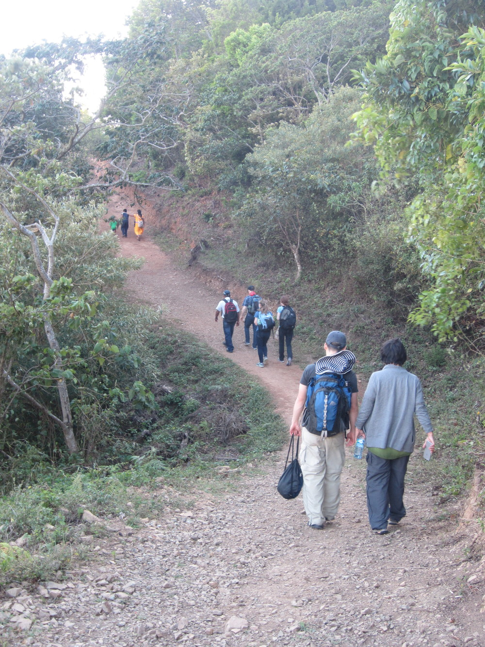 7. Hiking up to the village of Hato Ratón where many of our scholars live to stay with FFC volunteer Ramon Pineda and his family. The long pick-up truck ride and hike reminded us of the many transportation challenges our students face when going to school.