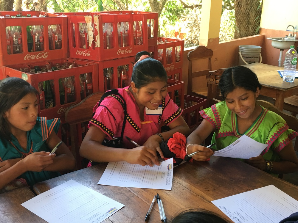 3. FFC scholarship winners Sindy, Emilia, and Xiomara C. share a laugh over their responses to our questions.