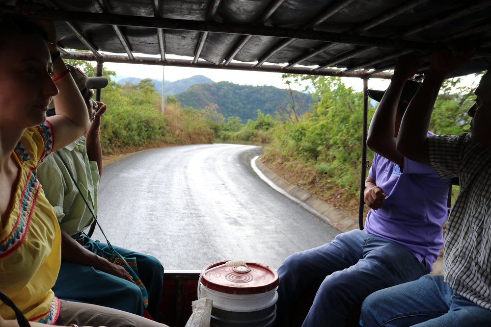 Few for Change members share a chiva ride with locals on the way to last year's scholarship ceremony.