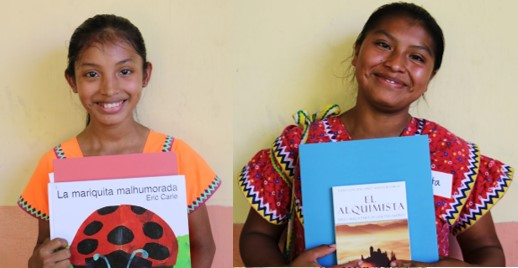 Scholarship recipients Yazmin (left) and Edita (right) with their new books!