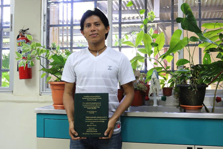 After sharing his life story, Olmedo stood for a portrait in the lab where he completed his undergraduate thesis. He is currently working on his Masters in Biology.