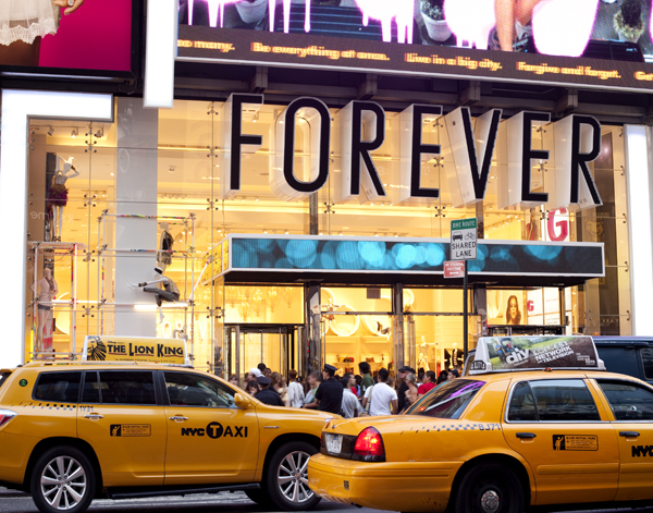 I visited the new Forever 21 in Times Square after work today. Exactly what I expected. Hell Fest. Its 4 floors packed with girls and their tourist families. At some points, I couldnt distinguish between mannequins and people. The dressing rooms ( which I counted about 3 per floor) had long lines and attendants were rude. I did find a tank to buy, so trip wasnt a total bust, but I'll stick to Union or Herald Square.