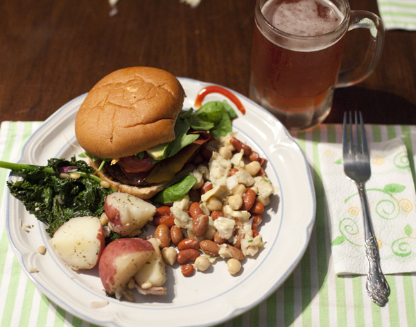 We've been making a lot of house dinners lately :) Homemade Black Bean Burgers with Kale and Potatoes and Bean Salad and Raspberry Beer.