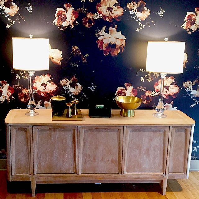 "Flower power! From our recently completed Bunnyrun project: Stunning #floralwallpaper  from @ashleywoodsonbailey titled ""The Hunt,"" #brass #centerpiece #pedestalbowl from @arteriorshome , vintage brass candlesticks, black & brass #icebucket from @targetstylehome , vintage #buffet, #interiordesign #interiordesignideas, #austininteriordesign #austininteriors #austininteriordesigners #atxstyle #interiordesigninspiration #ashleywoodsonbailey #arteriorshome #vintagefurniture #peonies"