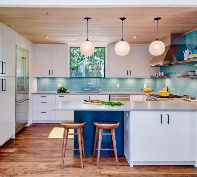 Love Ya Blue! The turquoise backsplash tile from @fireclaytile adds a happy dash of color in the kitchen of the #InterlockHouse remodel we completed with @mf.architecture last year. Solid Texas walnut floors locally milled by Hewn with a runner by @nannie_inez  and hand blown pendants by @nichemodern Built by Wall To Wall. Shoot logistics by @nitschecreative and photos by the wonderful @charlesdavissmith