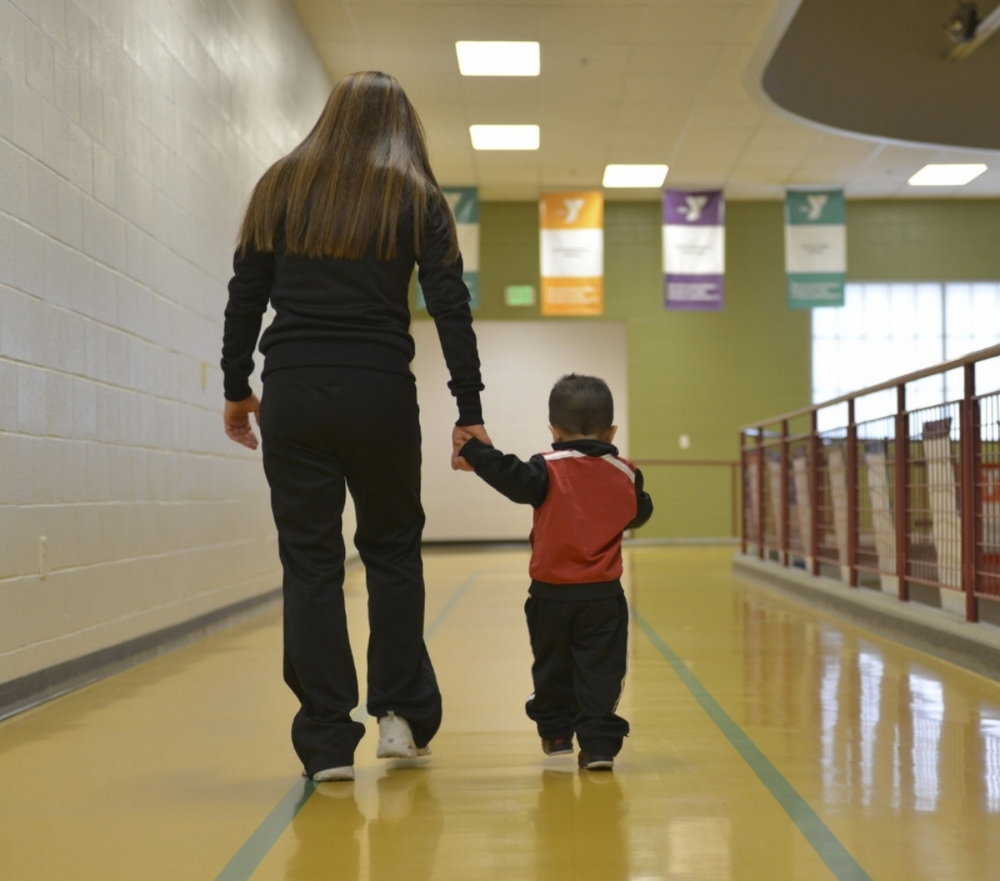 Ashley Kate and her young son spend time together on the YMCA track. He is her inspiration and her workout buddy.   Photo courtesy of Ashley Kate's personal collection.