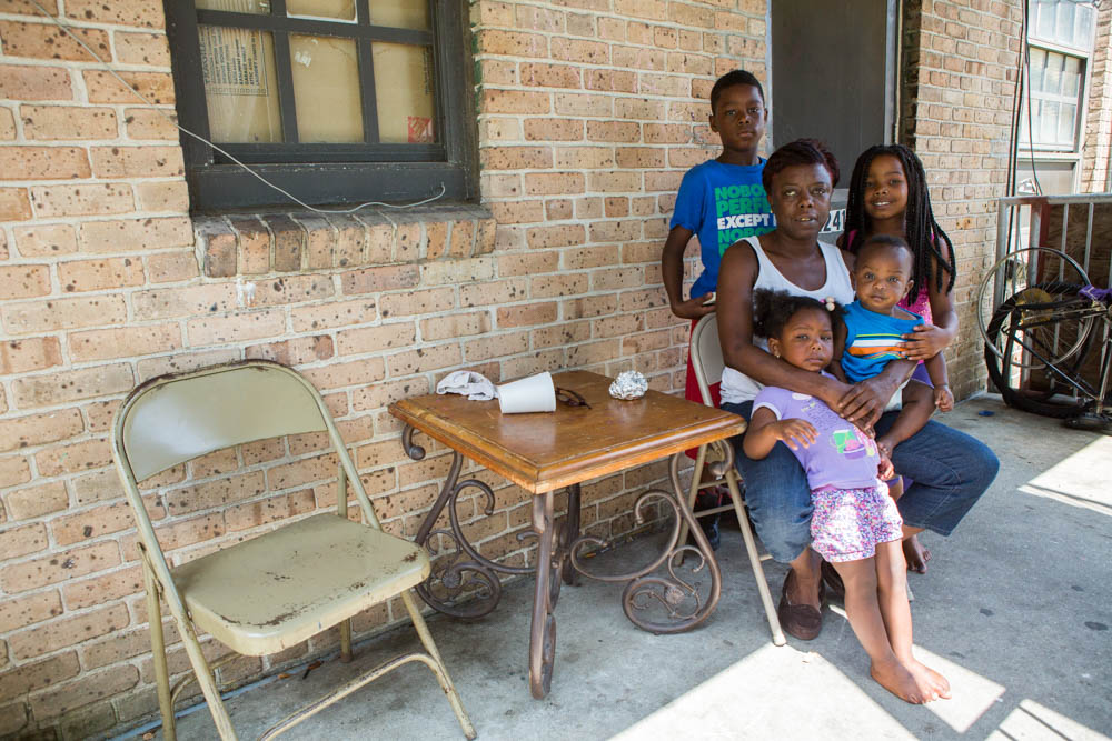 Williana Tadlock is pictured with her grandchildren, who she has adopted to make sure they can all live in public housing. Photo by Elaisha Stokes.