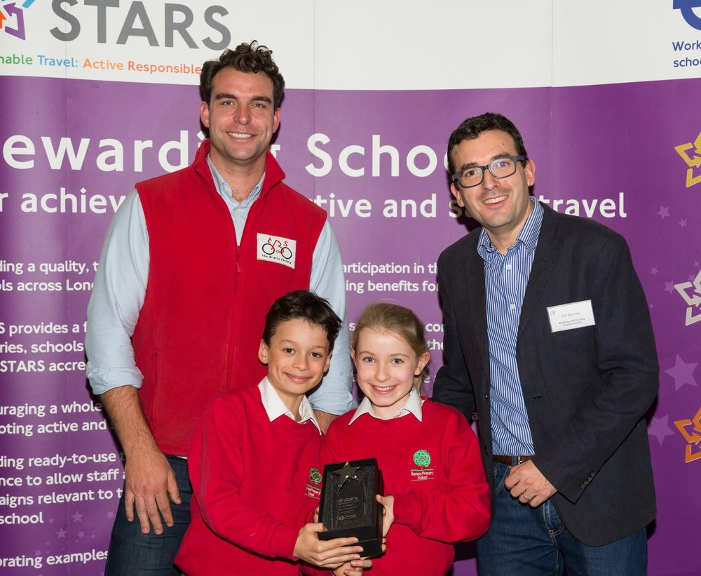 Rob (left) & children receiving a TFL Award - Cycling School of Excellence from Will Norman (right), TFL's walking and cycling commissionaire 2017