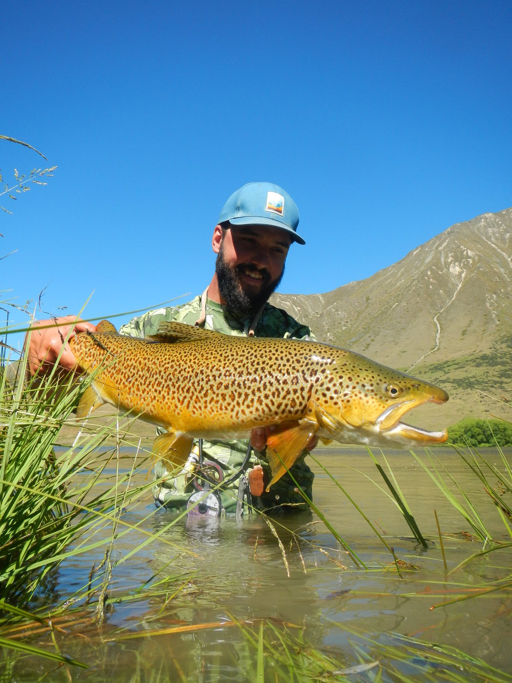 New Zealand fishing guide Jeff Forsee with big brown trout