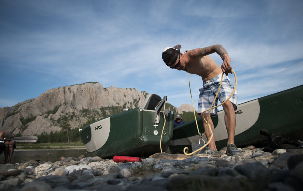 Mongolian fly fishing guide Jack rigging boats for the float