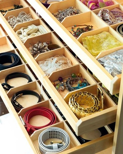 belt organiser in divided drawers