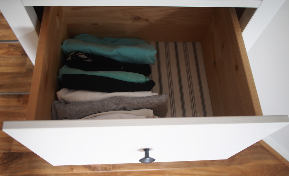 tops filed horizontally in dresser drawer for increased storage