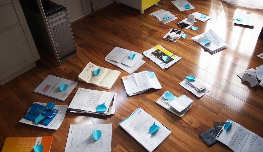 sorting paperwork into piles