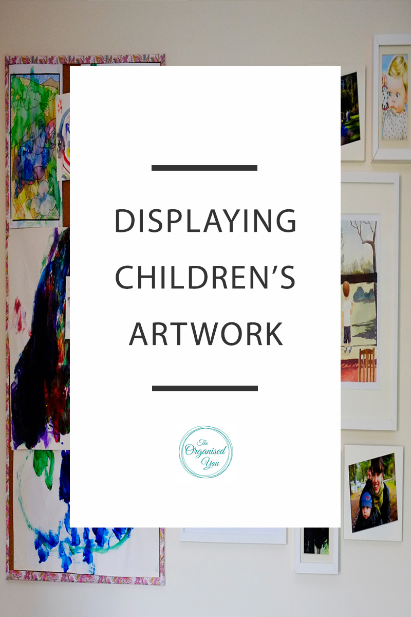 Displaying children's artwork - children are endlessly creating beautiful artwork, so how do you find a way to display it? Click through to read the full post on how we display artwork and incorporate it into a photo gallery wall, so the kids can feel proud of their precious works of art