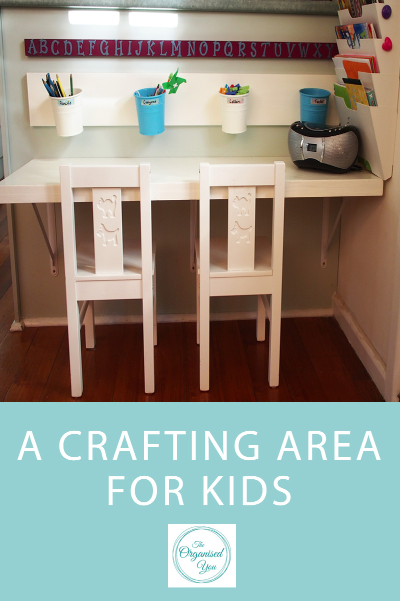 A Crafting Area for Kids - do you have a designated area set up in your home that is just for the kids? A place to store their craft supplies, for them to eat snacks, a special place just for them? Click through to read the full post on how we set this area up in our living area so that our kids always have a space that they feel is 'theirs', and is super-cute to boot!
