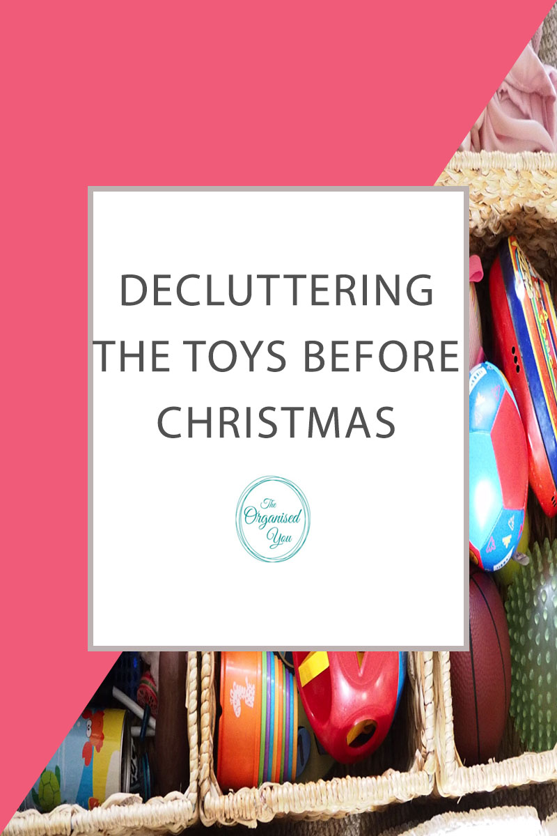 Decluttering the Toys Before Christmas - decluttering your children's toy collection before Christmas comes around and the presents start rolling in will make it less overwhelming when trying to find storage spots for the new toys. Click through to read about how we decluttered our toy collection!