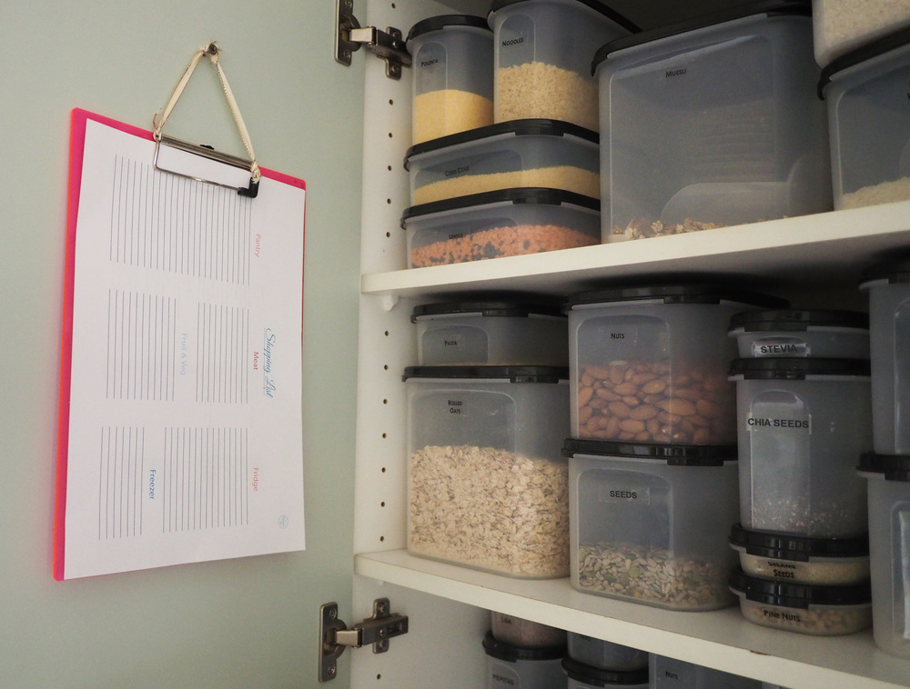 Lists hanging on clipboard inside pantry for easy access and to fill out when necessary