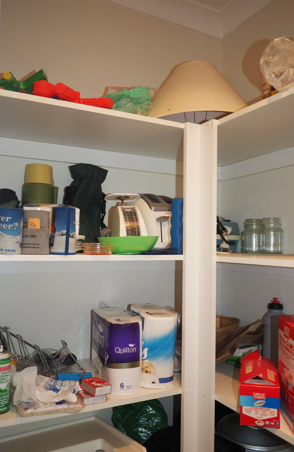 Does your pantry look like this? Cluttered, messy and disorganised? Click through to read the full pantry makeover, with organising tips and tricks for your pantry area