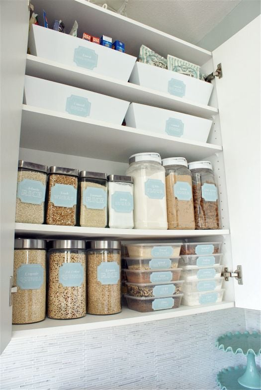 An organised pantry using dollar-store jars and homemade labels