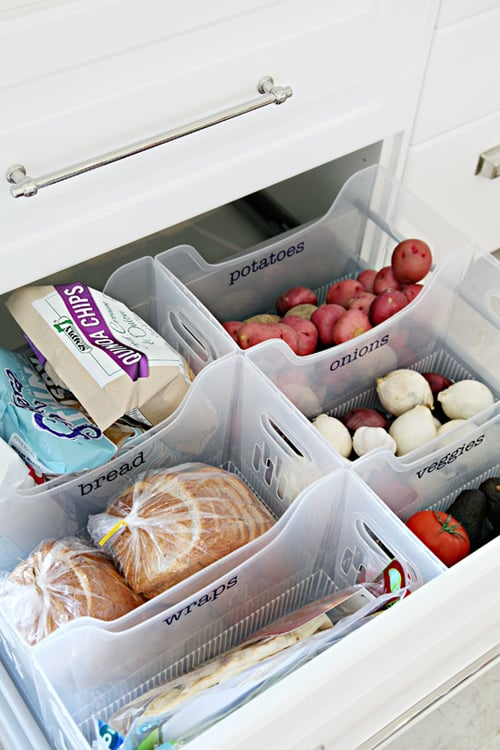 Use labelled multi-purpose bins to divide and organise items in a drawer