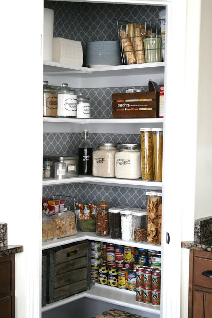 A decorative and organised pantry using labelled jars and vintage boxes for a pretty touch