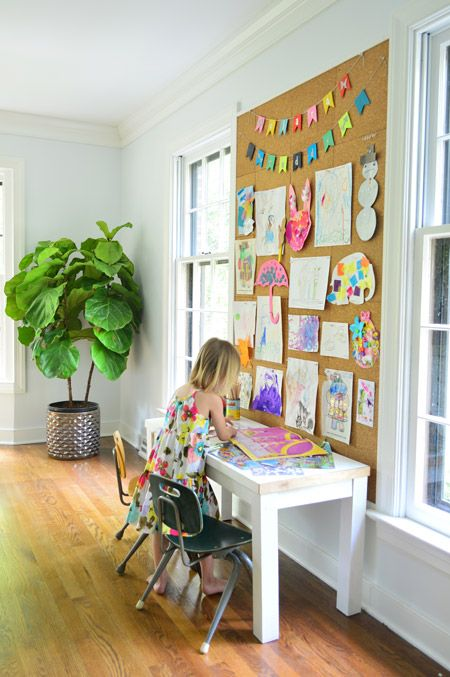 A giant corkboard to display your child's artwork in a fun way