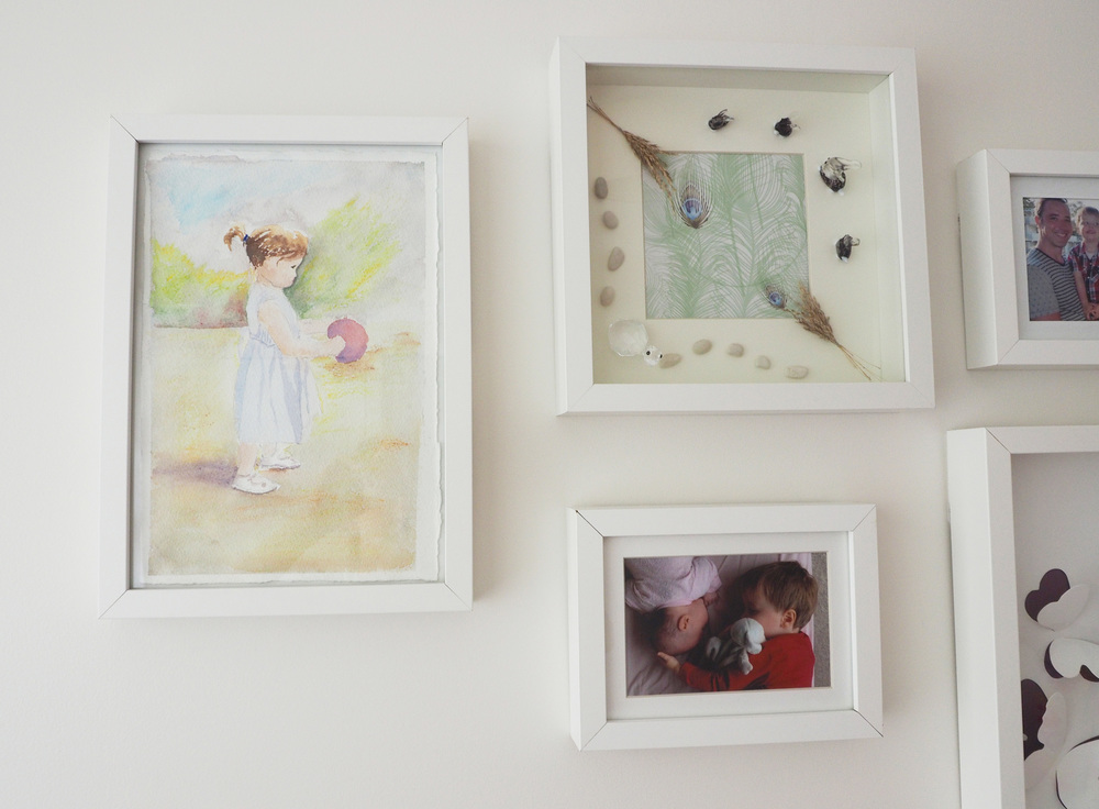 Photo gallery wall - beautiful paintings and photos to add visual interest to a child's bedroom