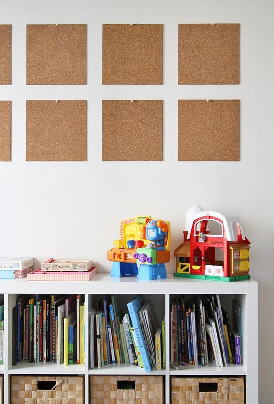 Corkboard tiles are a clean and simple option for displaying artwork