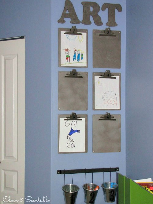 Kids art display using clipboards