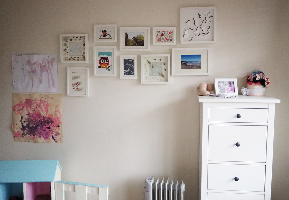 Bedroom photo gallery wall
