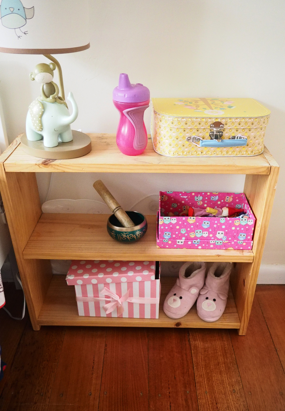 Making over an old shoe rack into a bedside table