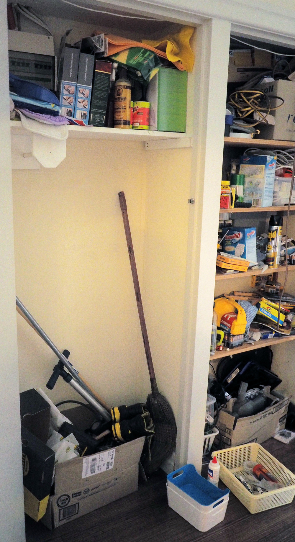 disorganised cupboard space