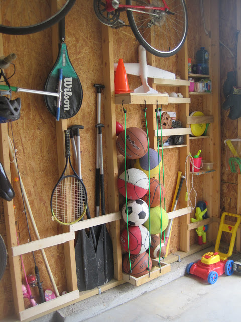 Use the studs in your walls to organise in the garage