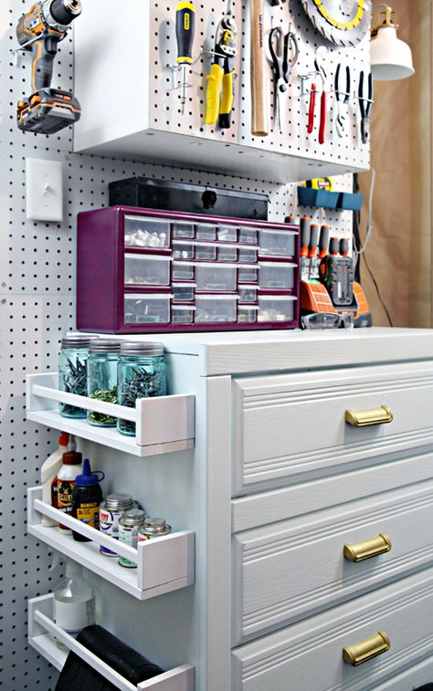 Pegboard and extra shelving creates more storage space in a garage for all the little bits and pieces