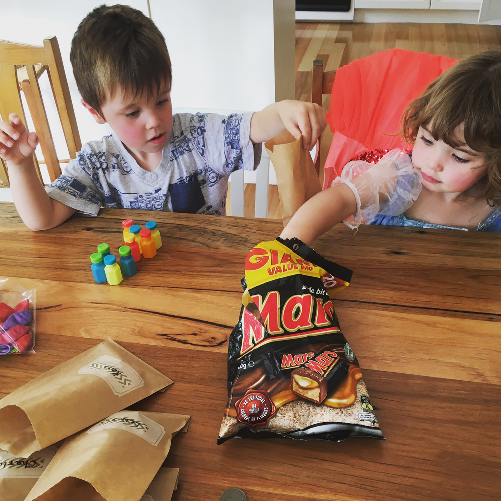 Get your kids to help out where possible in party preparation - filling the lolly bags is the ideal job!