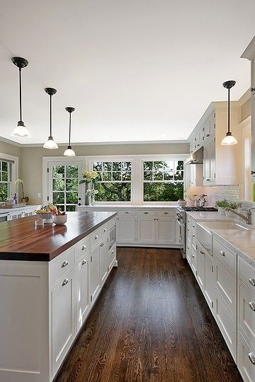 Gorgeous kitchen with wooden island benchtop
